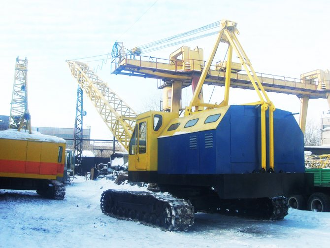 кран МКГ-25 до 40 тонн