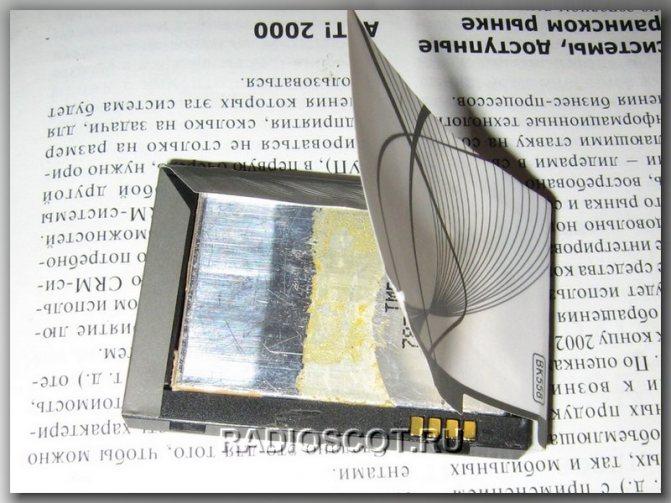 разборка наклейки АКБ мобильныого телефона